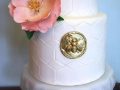 Wedding-Cake-With-Flower-and-bee-emblem